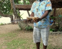Espirito Santo - opening a coconut at Cruising Safaris